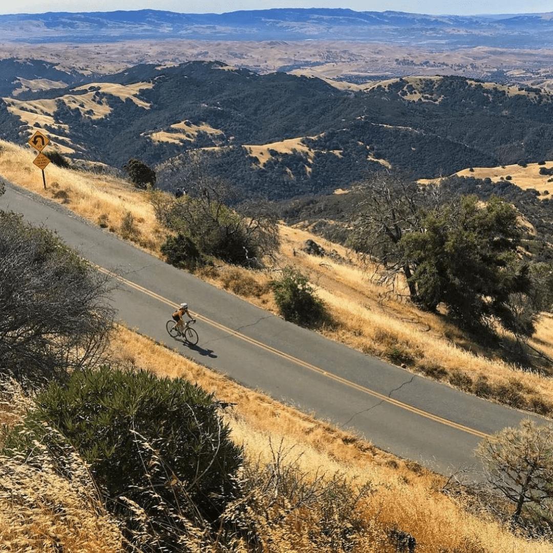 A cyclist bikes down Mt. Diablo State Park roads