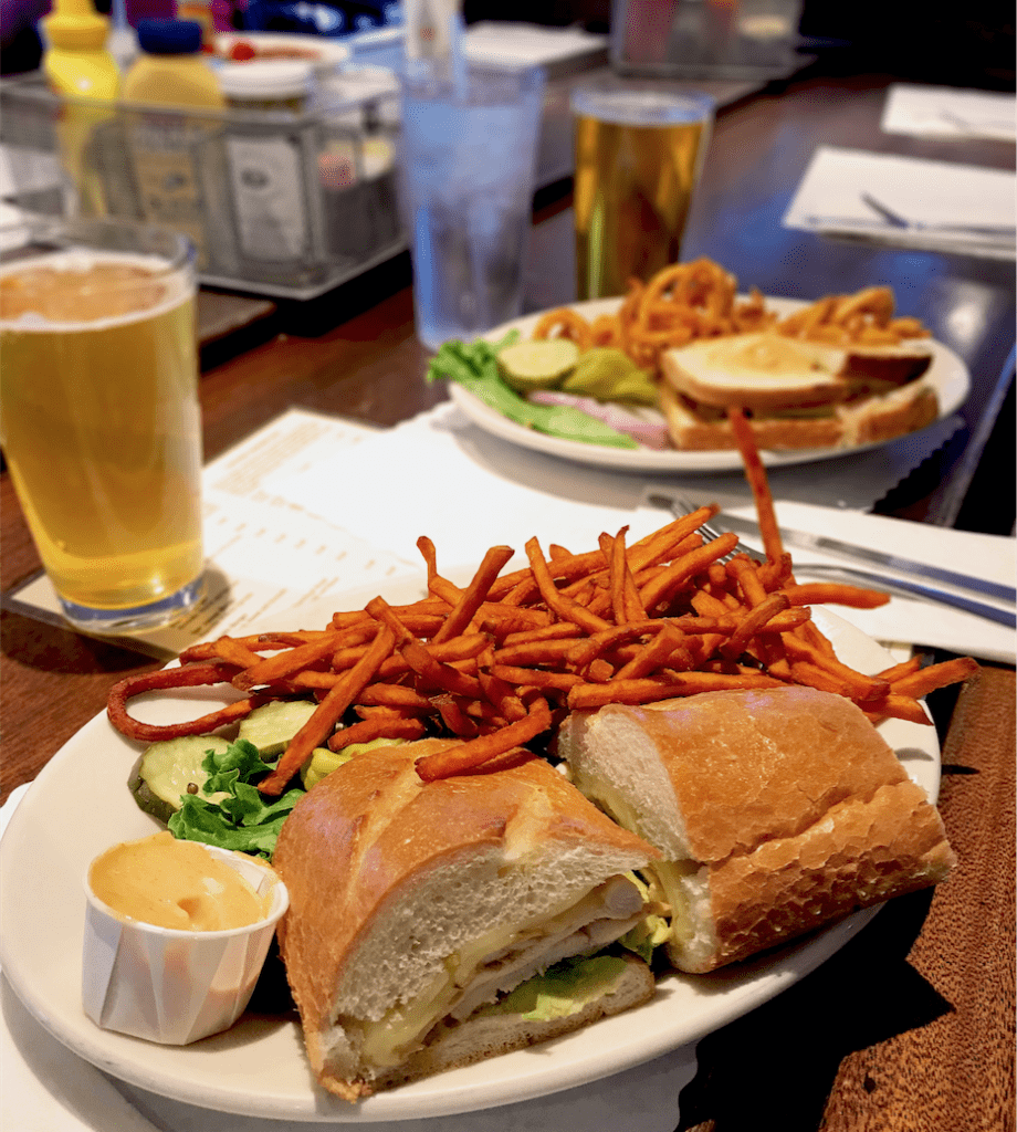 Delicious chicken sandwich with sweet potato fries from Peet's Brass Rail & Car Wash