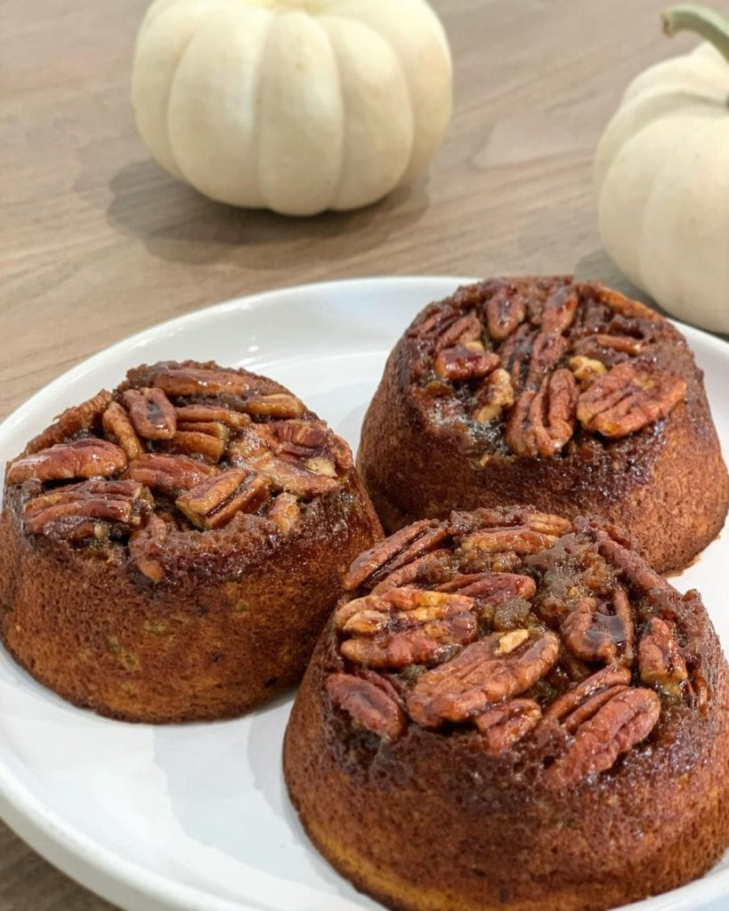 mini pumpkin cake topped with pecans