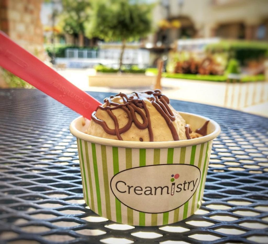 cup of ice cream with hot fudge on top at creamistry