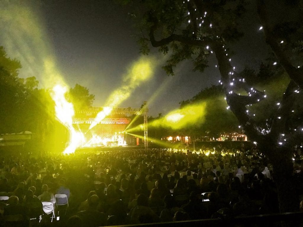 Photo of lights shining on the stage of a concert at Wente Vineyards in Livermore, CA.