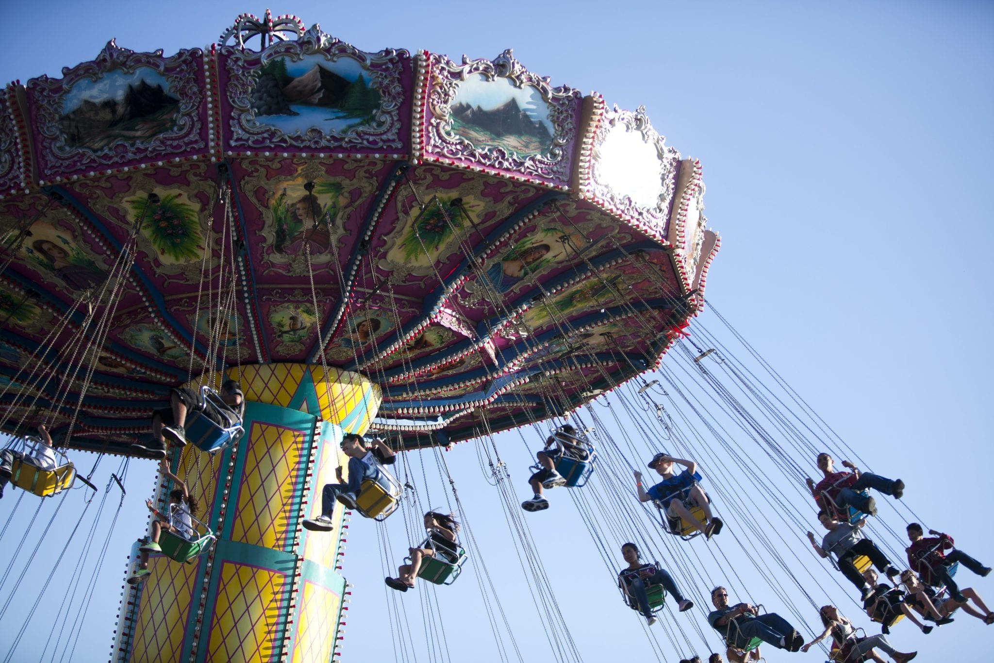 Photo of fair visitors on a large swing ride at the Alameda County Fair in Pleasanton, CA.