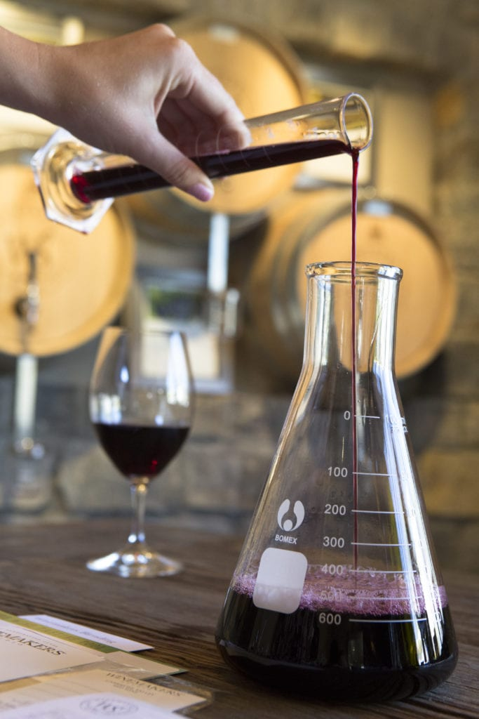a beaker filled with wine