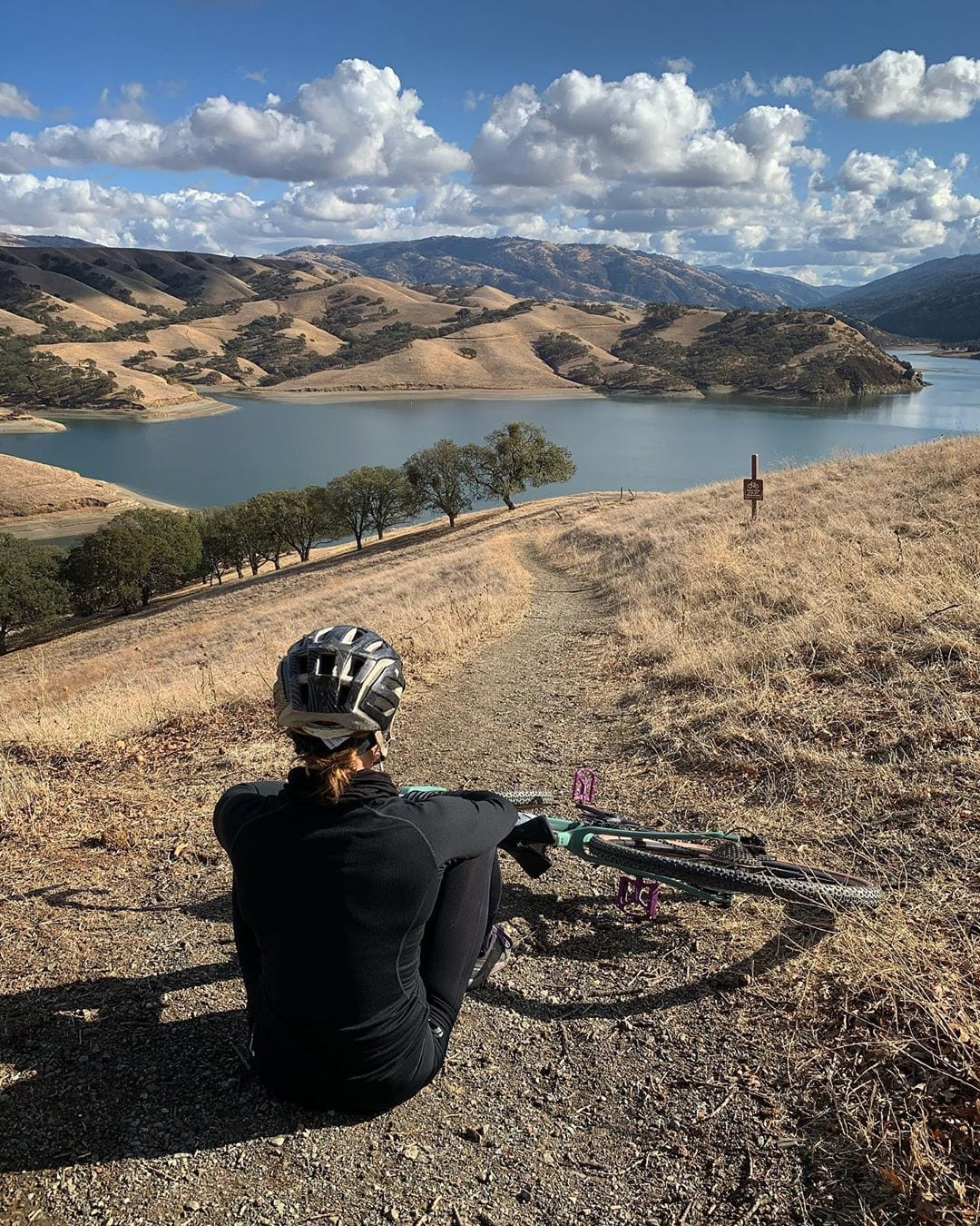 Bicyclist overlooking Lake Del Valle, Livermore, CA