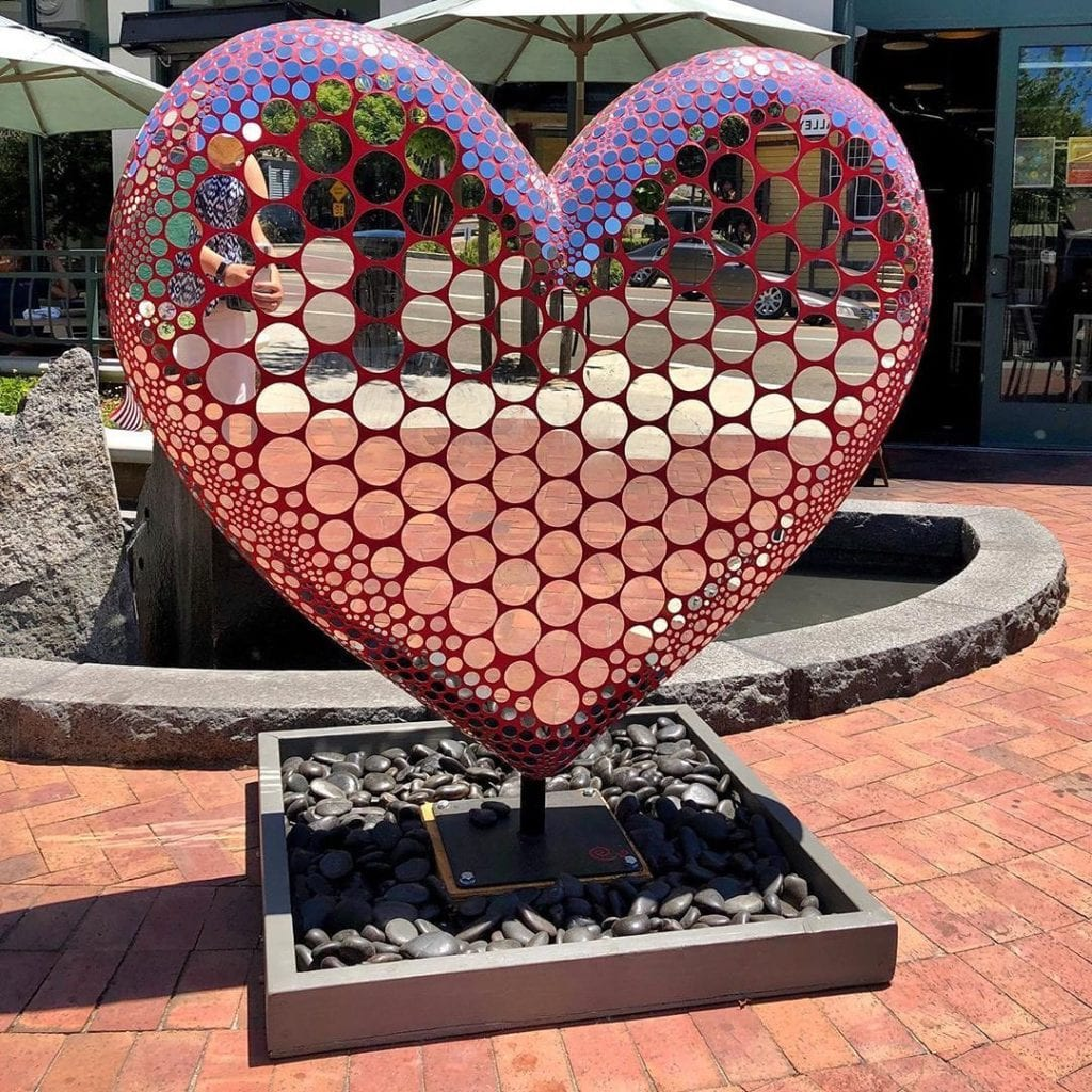 public art installation of a large heart covered in mirrors