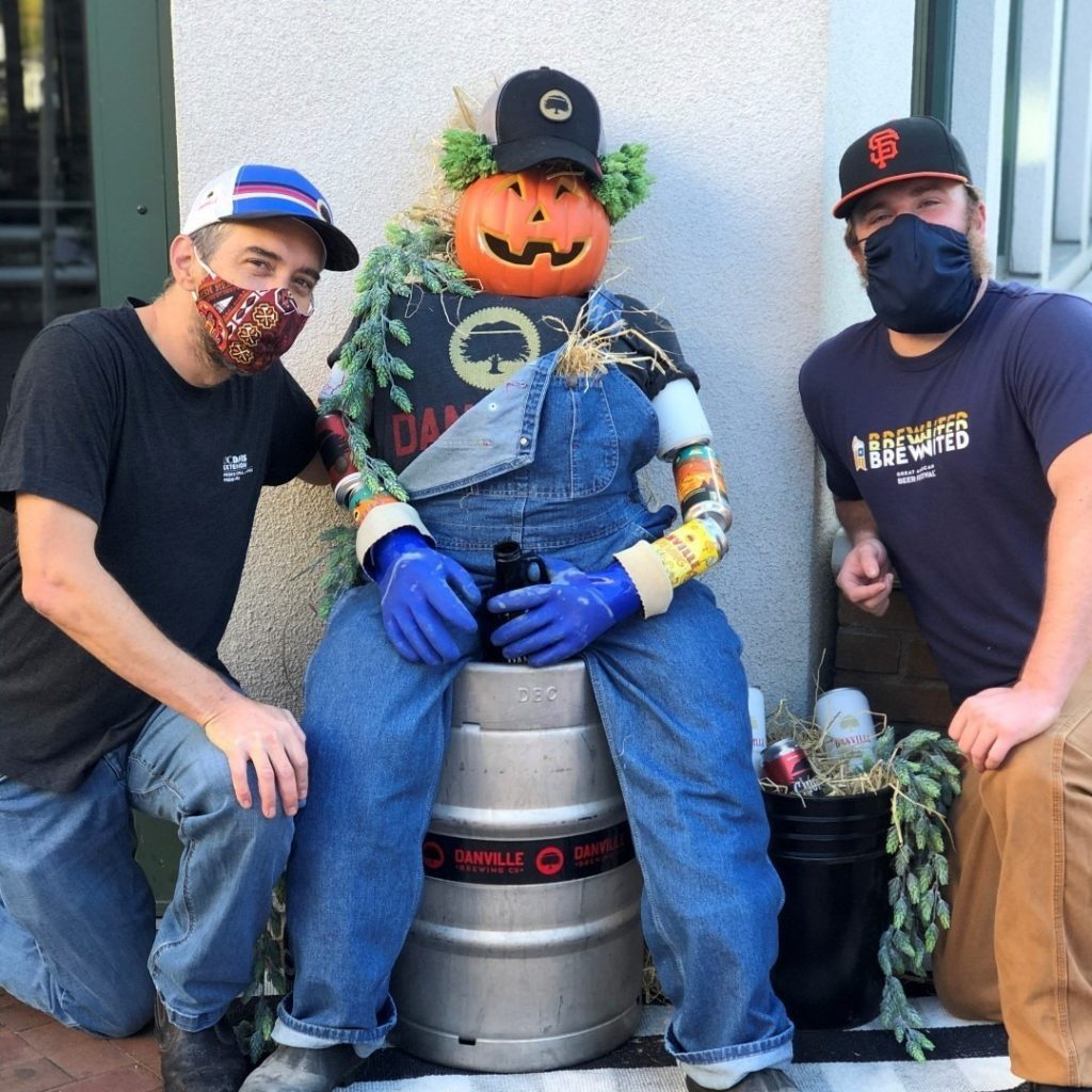 danville brewing employees post with scarecrow