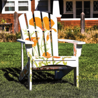 public art installation, large California poppies on adirondack chair