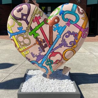 public art installation of large heart painted with keys