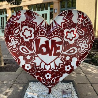 public art installation of a large heart painted with designs